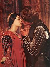 Romeo kisses juliet